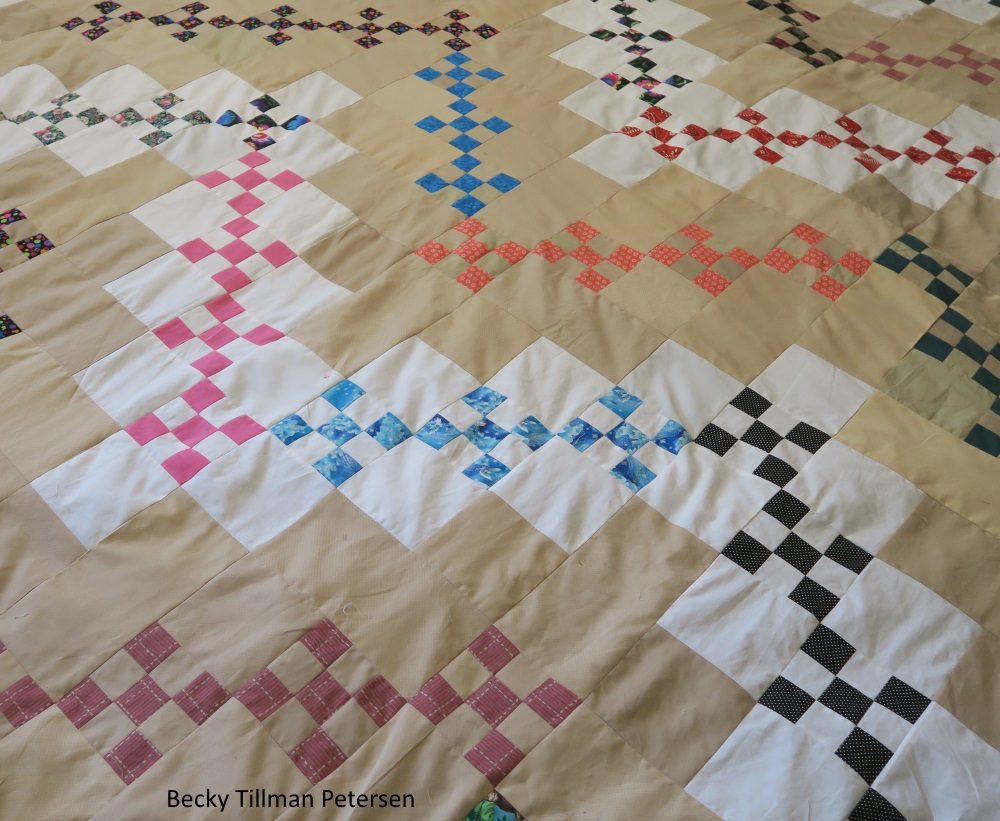 "close up of quilt: those quilt blogs are surrounded with the color of the background of the 2 inch squares containing the miniture squares. The ""lightning bolts"" look very thin and skinny, but fleshed out with the background (extendiing the width of each bolt)"