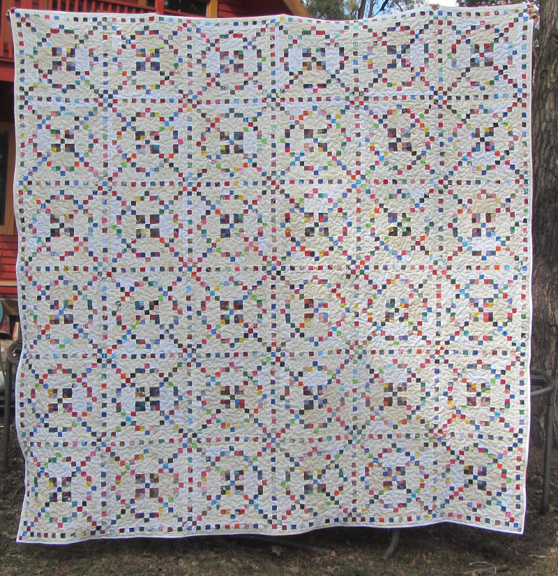 "I made this one a scrappy with an off white background. Quilt finished at about 110""x110"". I gifted this to a pastor and his wife. Pattern - Burgoyne Surrounded."