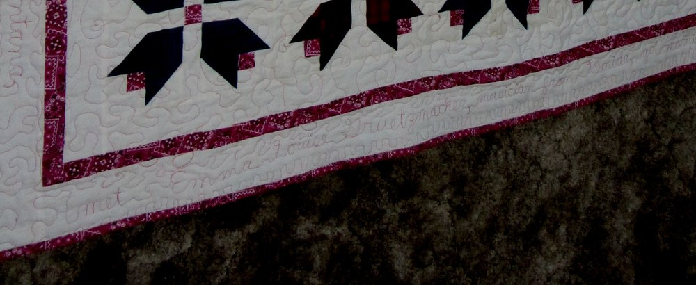 I tried to darken up the picture so you could see the words. Obviously I don't have the quilt with me at this time to retake a better picture - as it's in my mom's house in FL.