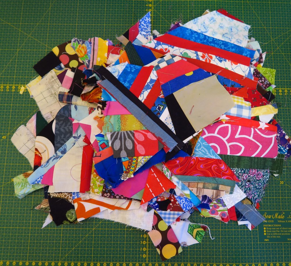 "I'm going to use these to cut into 6.5"" squares to be used around the edge of the quilt as the border.  I was thinking of using the 3.5"" squares and piecing them together as I did for the center, but just to mix things up a bit, I will probably just try to make 6.5"" blocks so I don't have to piece - LOL - as if I haven't pieced any to get that 6.5"" block! (such a joke!)"