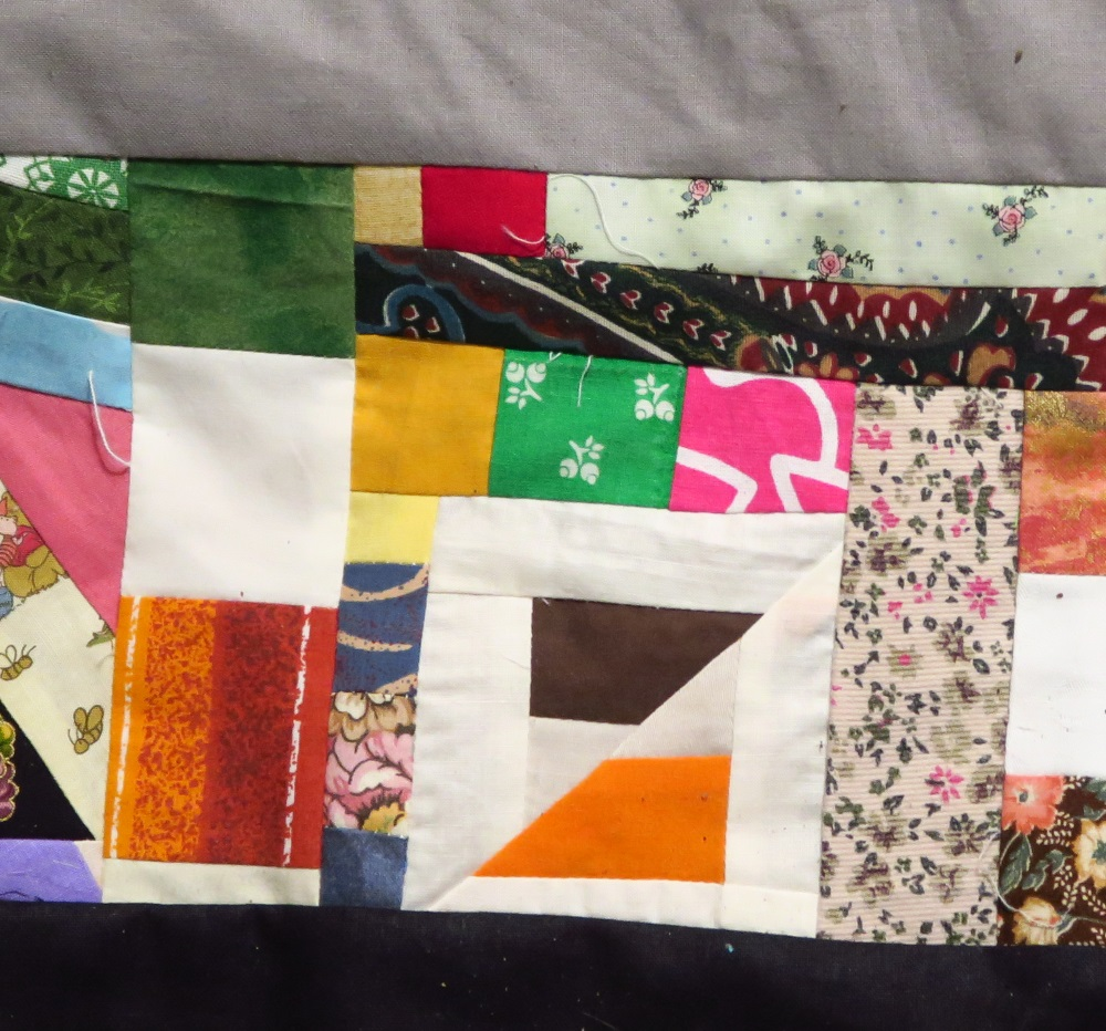 "Those off white and orange/brown pieces were part of the edges I had to trim off since I made it on point - the ""HI"" quilt top I made recently."