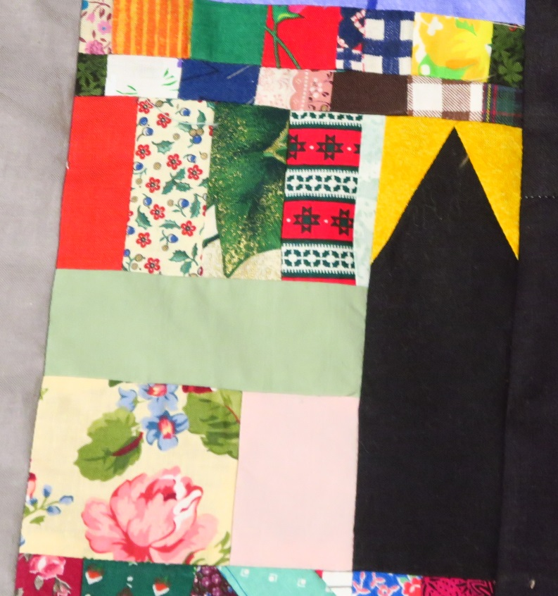 "This black and yellow sashing was a block I changed my mind about. I may go back and change my mind again - I haven't finished that particular 2"" strips top yet."