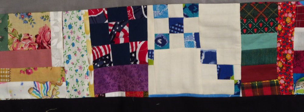 This part of a chain blocks is something I decided not to make. The patriotic block next to it was a 9 patch that originally went into the corner of a top I made earlier this year. I hated the look and took this out and put in a plain navy square instead.
