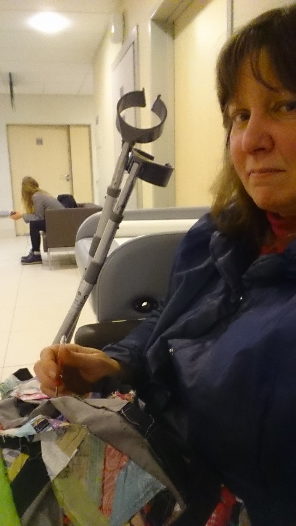 This may be the first selfie I've ever taken.  It was hard to do it with one hand holding the seam ripper and one hand on the camera.  Guess I'll need more experience.  This is while I was waiting for Mike to get an x ray. He was waiting over close to the x ray room.  He was sitting in the wheelchair so he would be first in line at the door.