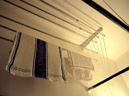Above the tub drying rack. It seems a bit complicated to set up, but would be a pretty handy space saver!