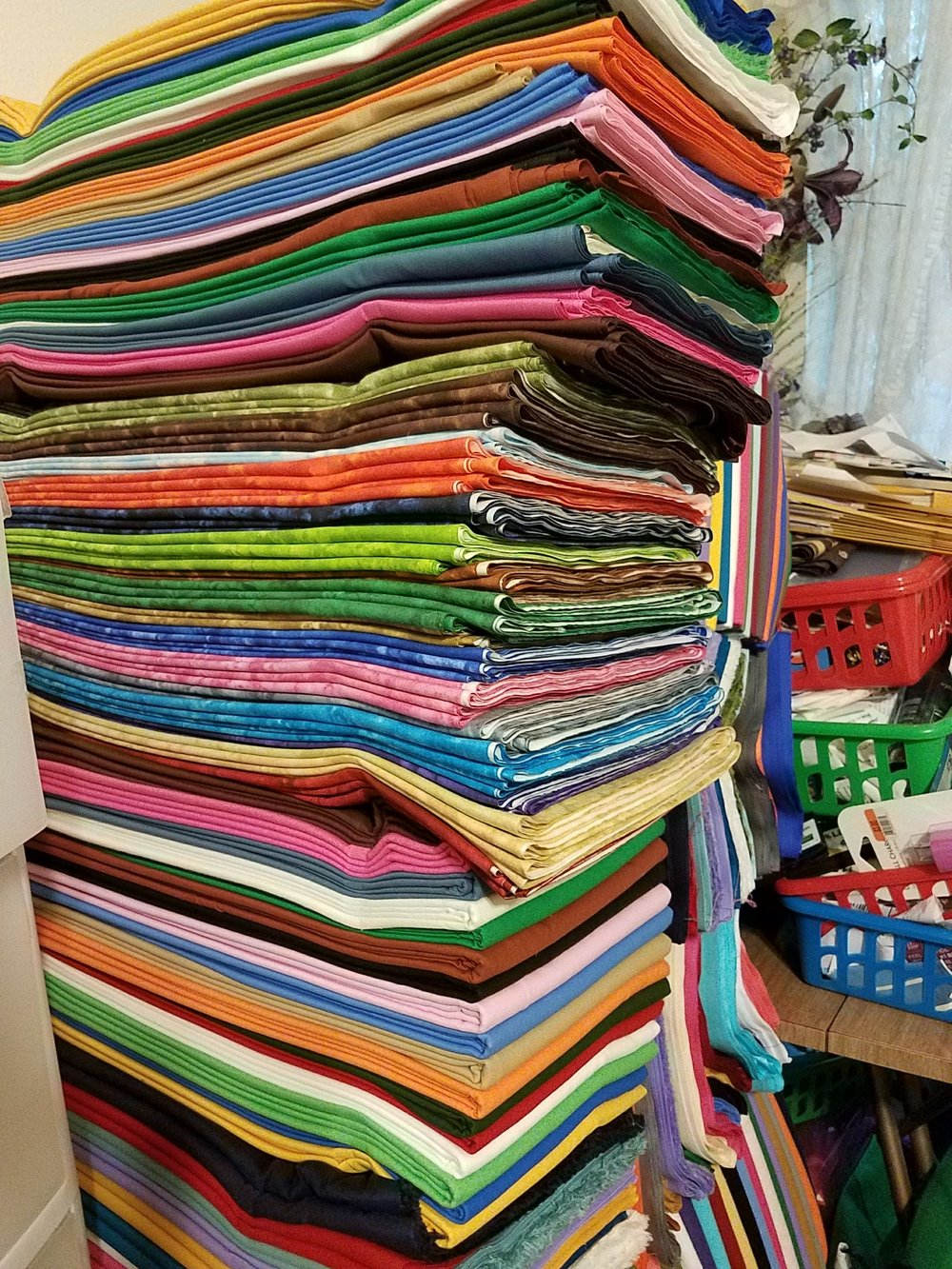 I know there is some fabric mixed in here that is not solid, but this is piled pretty high. I left the picture uncropped so you can could see more solids peeking around the back as well.