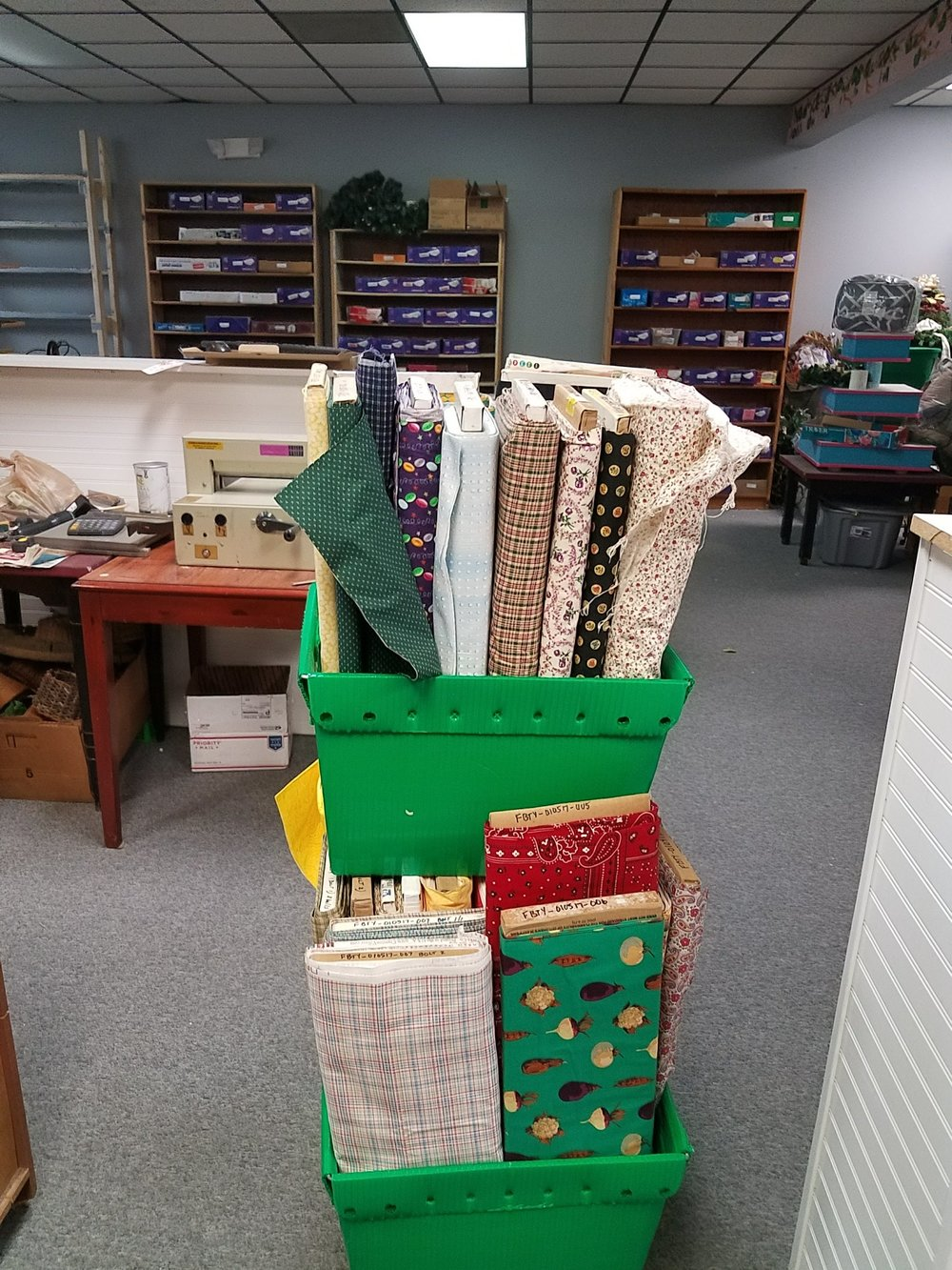 The beginning  - Our first cart of fabrics was ready to shelve..