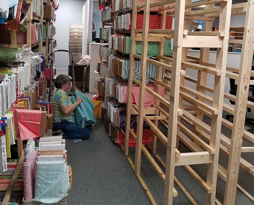 Putting fabrics on the shelves - Some of these had been briefly stored in the kitchen area, so I was starting to feel some relief and less overcrowding of the walk areas.