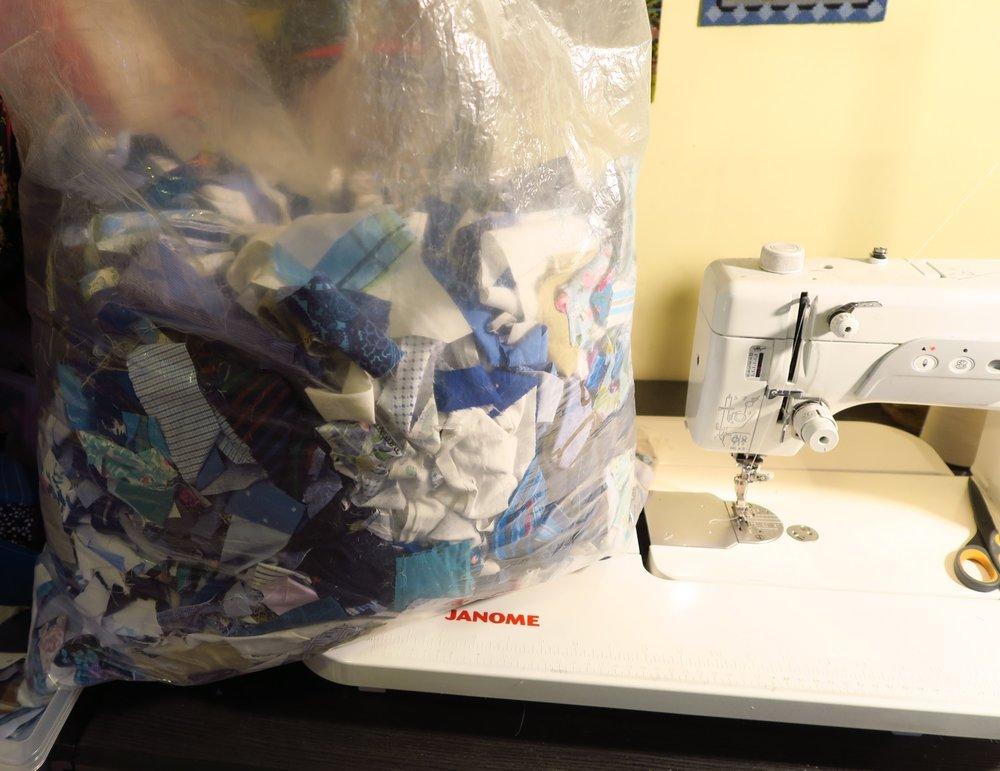 "This bag that I'm using to sew on  to the adding machine tape is pretty good sized and is over half full of scraps - leftovers from the recently  made tops. I may dig through them some more and cut 1.5"" strips from them as there are many pieces large enough to do that. We'll see."