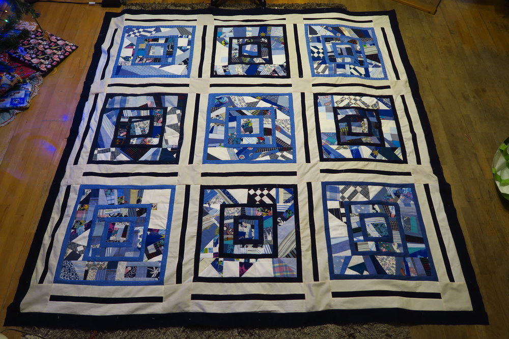 "It's kind of lumpy there because it still has paper behind it - not the cream part, but the other part, making for a somewhat stiff quilt. I'm going to go all out and try to quilt this one with the paper left on, then I'm going to wash it and see what happens. I'm hoping that when the paper dissolves, it should go right down the drain of the washing machine as it has to come through the fabric in order to come ""out"" of the quilt."