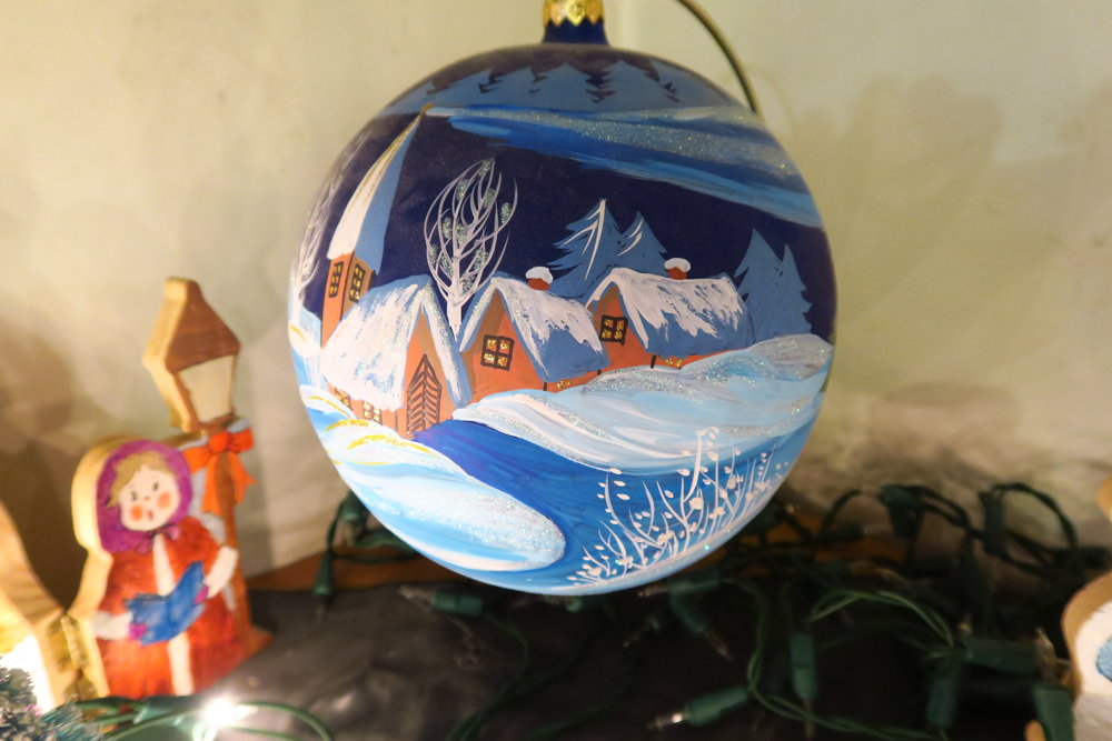 """Just before we put these things away, I wanted you to see our big Polish """"bombki"""" (glass ornament) - it has this on one side and Santa on the other. It was a gift from a friend."""