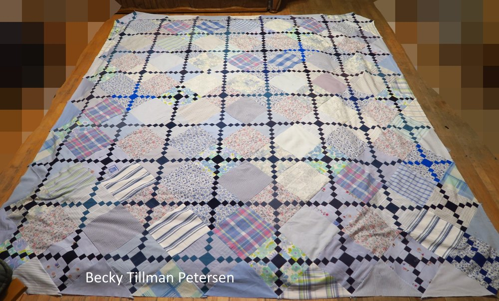 Can you find the mistakes?  They are kind of obvious when you lay the quilt top out flat like this and take a picture! Somehow as we worked, on it, I didn't notice the turned parts of blocks. I hadn't put on the corner setting triangles yet. I do that very last.