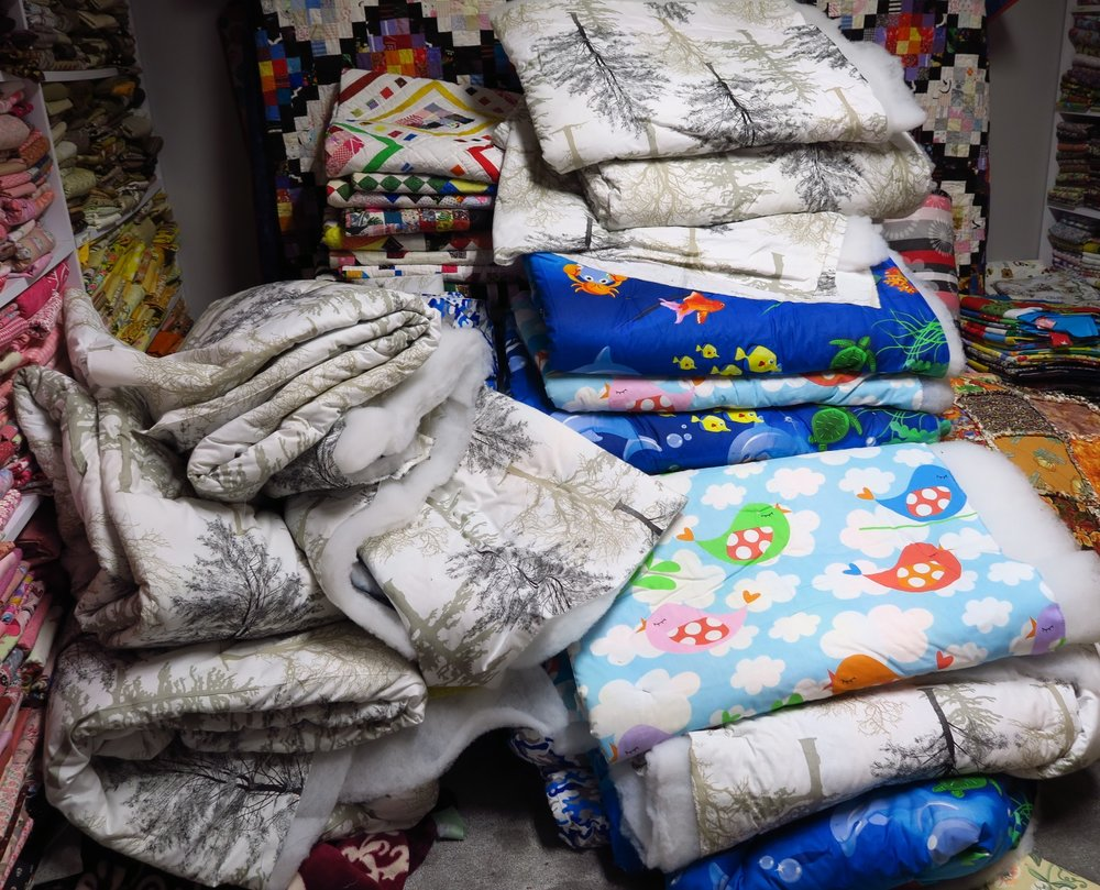 I have the sandwiched quilts in my son's room - the pile is getting somewhat smaller, but still quite significant.
