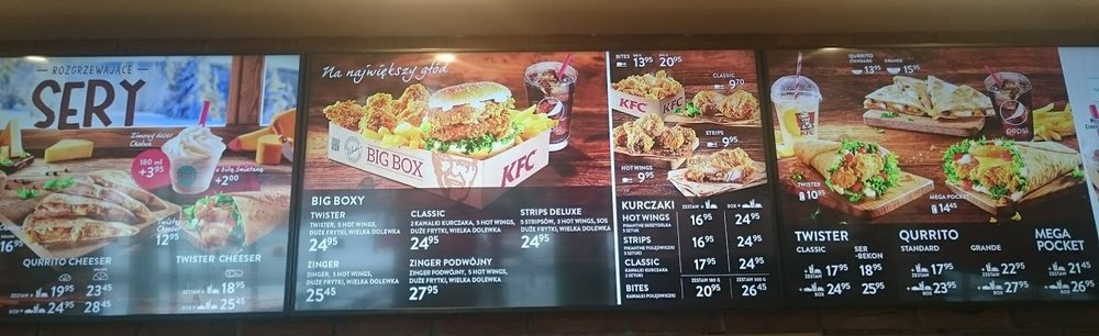 "I gave you a close up of the prices.  We usually get the ""Big Box"" as it has a drink you can refill, fries, a a sandwich or whatever you get like strips or pieces, plus 5 hot wings.  To figure the prices in US dollars, just divide by about 3.5. The prices are shown in Polish zlotys."