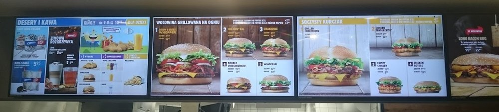 The board advertising their specials looks pretty similar to what you'd see in a typical American fast food restaurant.