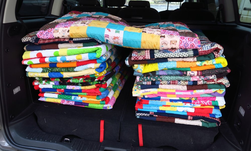 "Here are the last 20 quilts in the back of the ""new to us"" minivan we got earlier this year."