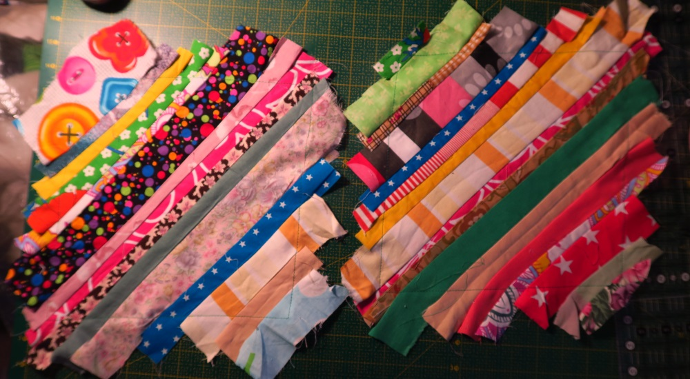 """First I sewed strips to a 10"""" piece of fabric."""