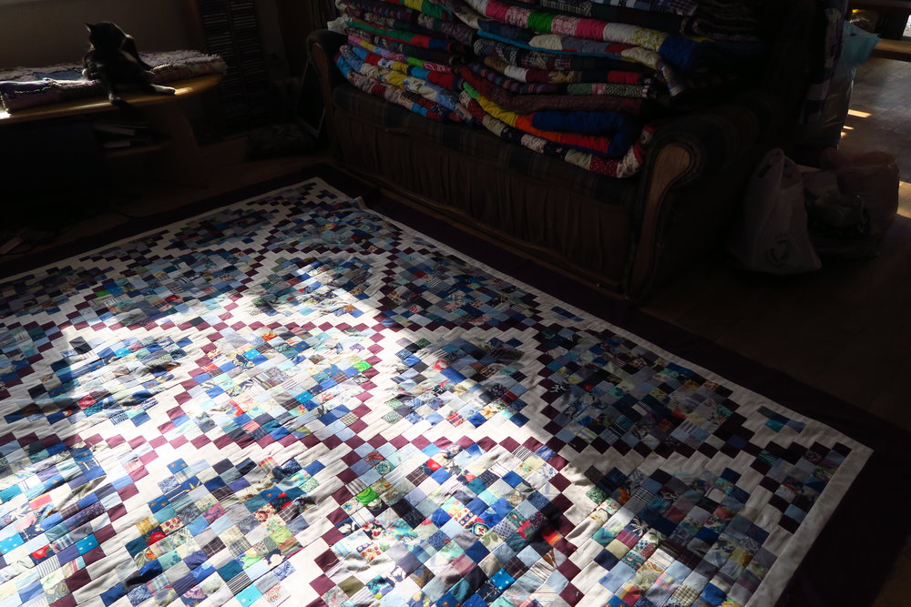 You can see charity quilts here - on the couch. I was having quilt a time getting it all done at the same time but when I just HAD to do something other than those - just as a break! Plus, I really was trying to get the blues down into two boxes..