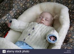 Baby sleeping in a baby carrier, like those in Polish Culture
