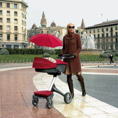 Lady pushing a baby stoller in poland