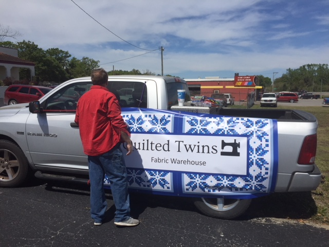 I bought 2 banners and my husband was hanging one on his truck since we don't have our more permanent sign up yet.