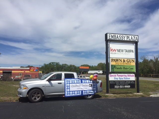"""Ken then hung balloons on his truck to get still more attention. Our more permanent sign will go right where it says PAWN & GUN in yellow! That should soon be our blue and white sign! Right now it's a yellow and black, """"Pawn and Gun Shop"""" sign."""