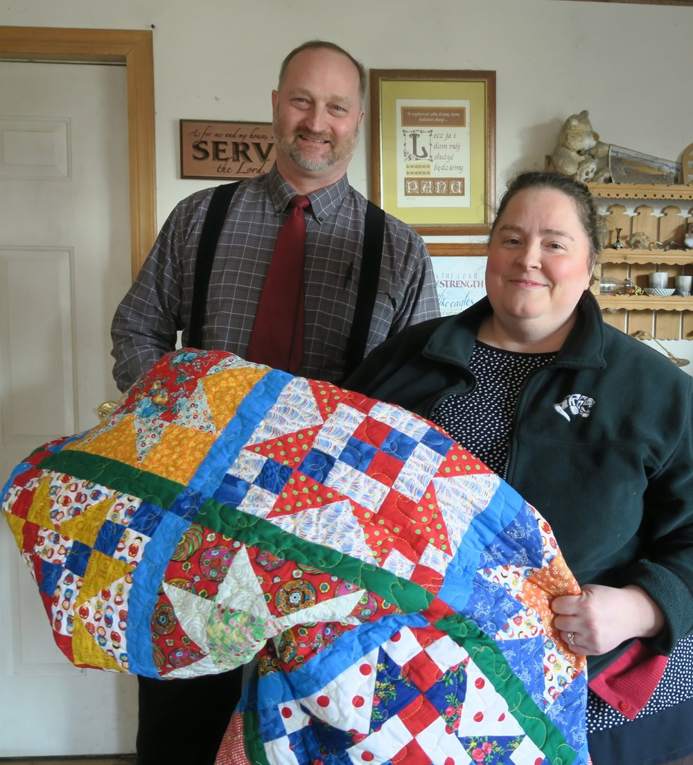 Polish People Holding Quilt