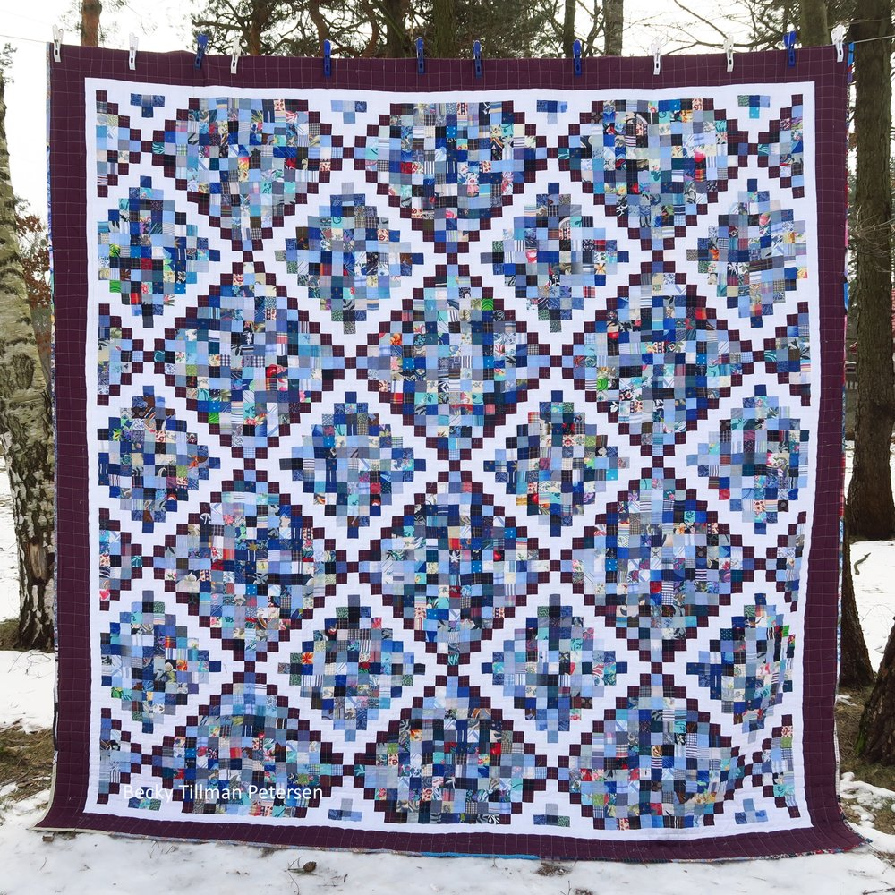 "This one finished at 107""x107"" so it is a king size quilt - and very elegant looking - at least as elegant as a scrappy quilt can look!"