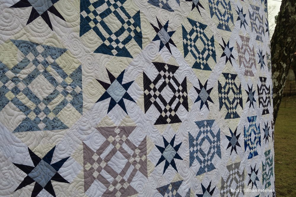 Starring Monkey Wrenches Quilt In Forrest