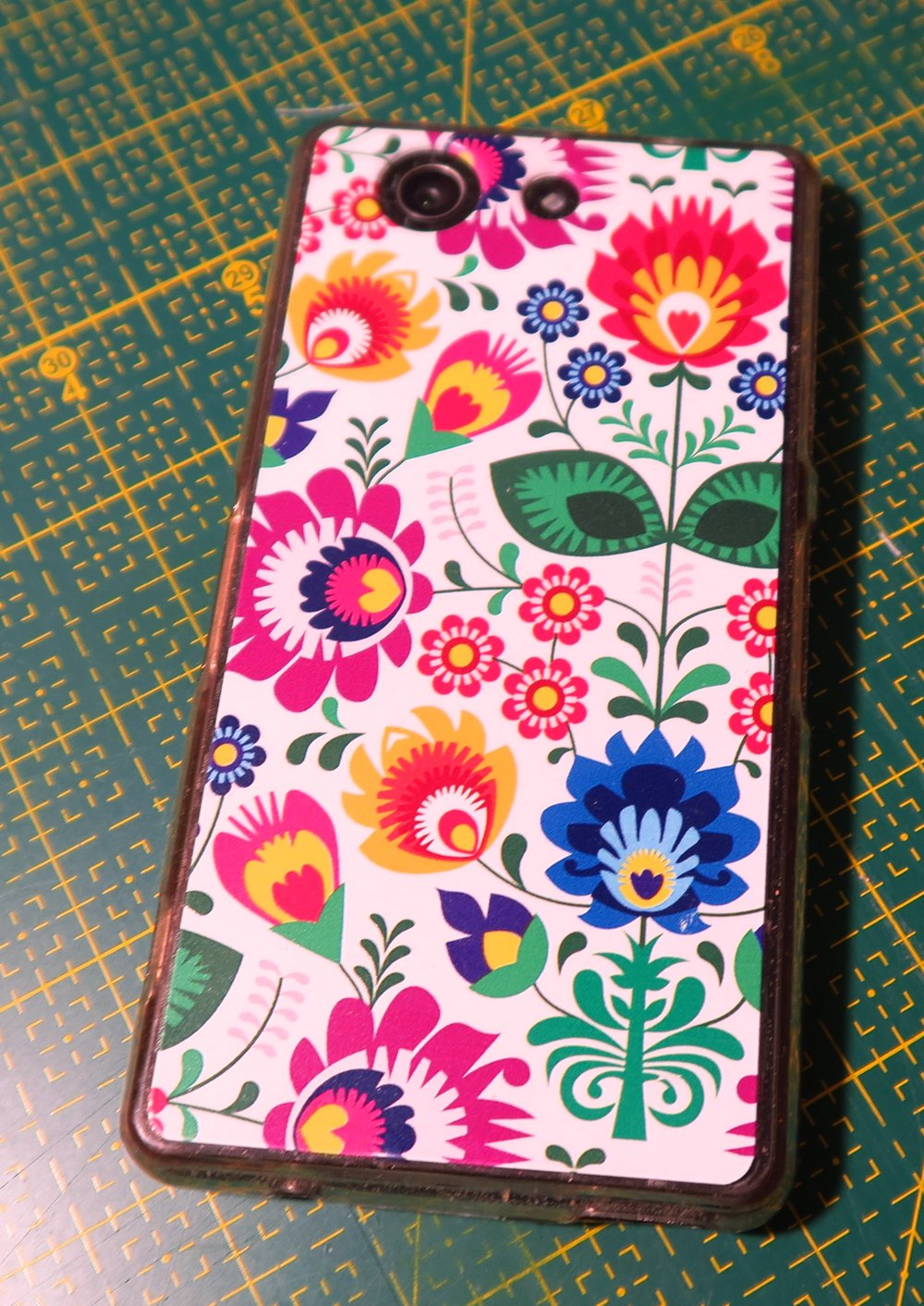 Anyway...here's mine. I was able to get a pretty Polish decorative protector for it - to help keep it from breaking when it tumbles to the ground! It's not a very big phone - I'd probably like a bit bigger one next time I upgrade - which I'm not looking to do right away.