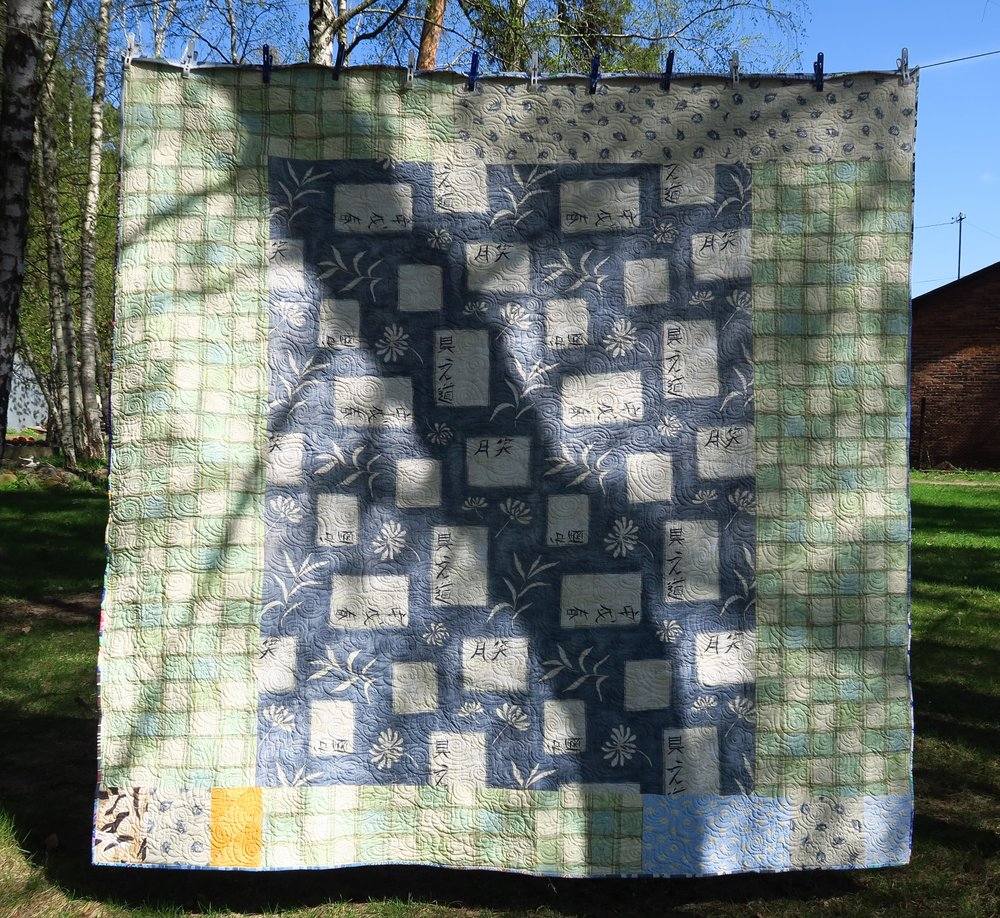 I know there is a strong tree shadow right across the middle of this. But, since it is the back - I didn't take the quilt back out, hang it up and redo this picture. It is merely so you can see it anyway - I had to piece quite a bit to get this size.