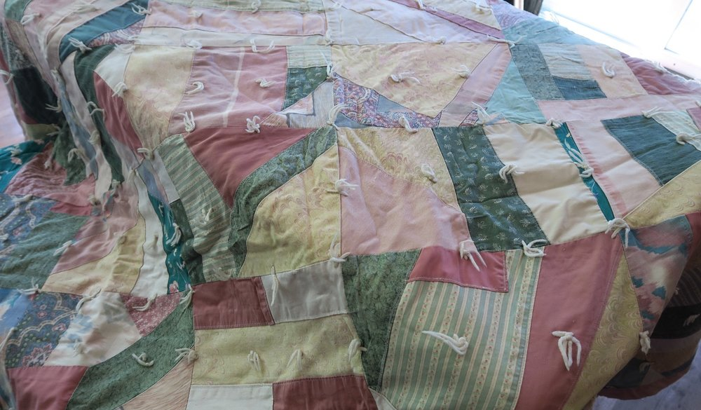 We used this quilt on our bed for years. It is heavy and warm! This crazy quilt was made by ladies at Community Baptist Church in Croswell, MI.