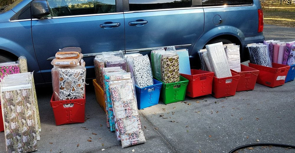 Color coordinating the bolts - Here you can see that I was dividing the bolts up by color and a whole heap of Halloween fabrics are in the bin by my driver's van door. Some bins get full faster than others, which translates into more on the shelf!