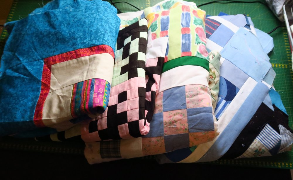 Four more very different tops. The only small one is the QR code quilt - need to get that one done ASAP.