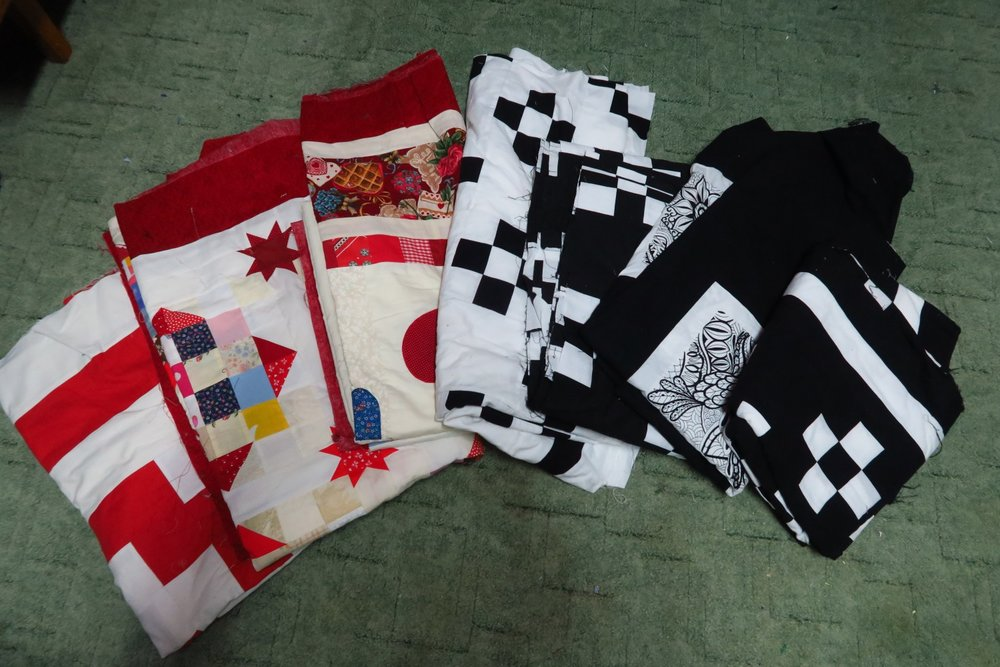 """Older ones. That middle one is a king size - enormous. Has hearts and applique - and I was scared to attempt quilting it when I made it. I'm really not so scared anymore. The others just don't inspire me but I need to finish them whether I am """"inspired"""" or not!"""