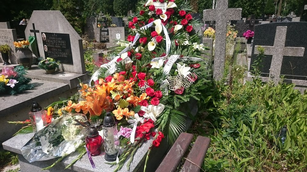 This is how the new graves always look here.  Piled with flowers! Lots and lots of them!