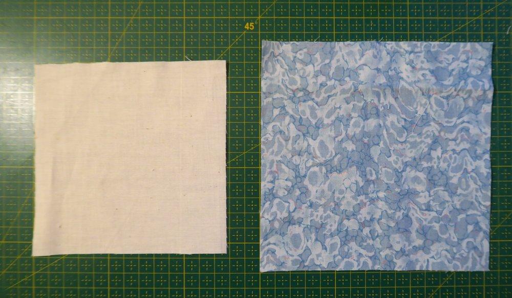 "Cut a white 5"" square and a blue 6"" square"