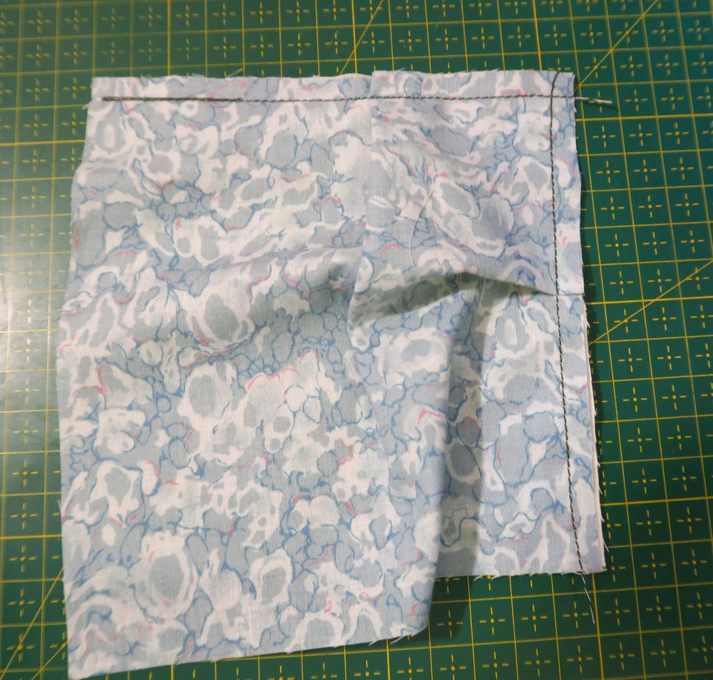 """Sew the pleat in along the side at 1/4"""" or less."""