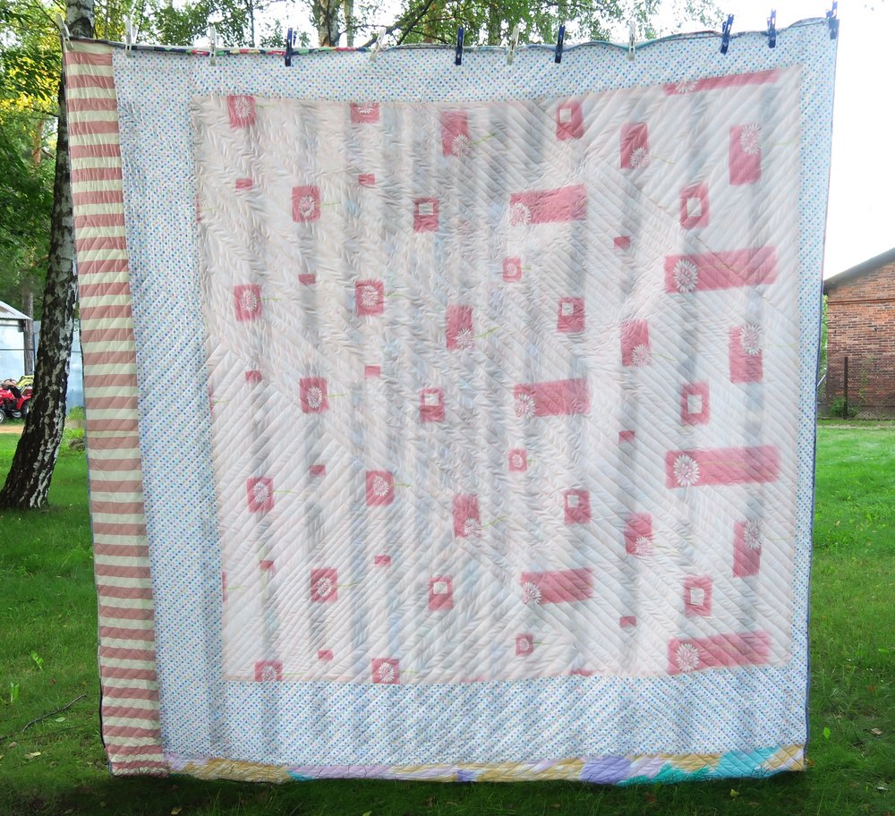 The back of the quilt. All upcycled fabrics. I pieced this top. It's crazy! I figured it really didn't matter - as that was pretty much the theme of this quilt!