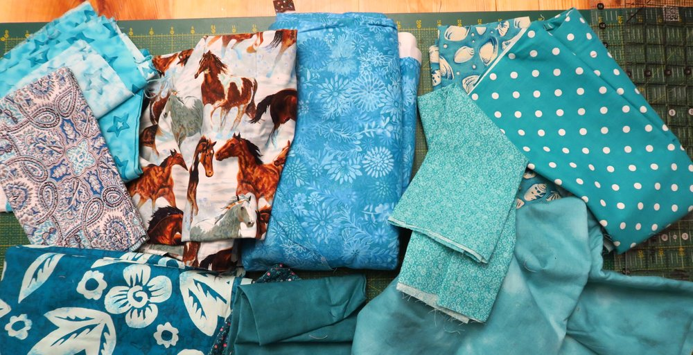 I was trying to find fabrics that would be defined as turquoise. My daughter in law helped me understand which of these is defined as turquoise, which is teal and which is just blue.