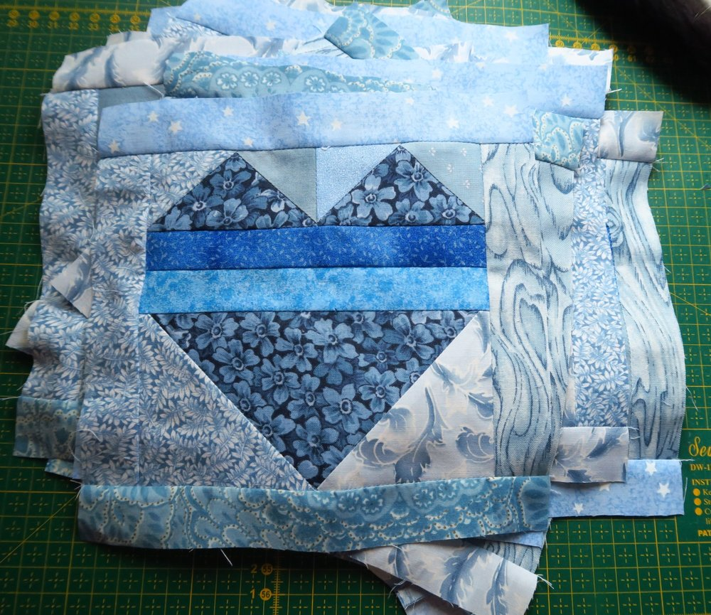 """I added a 1 1/4"""" strip to each side to make a block that was 8"""" unfinished but would finish in the quilt at 7.5"""" - the same as the checkerboard blocks"""