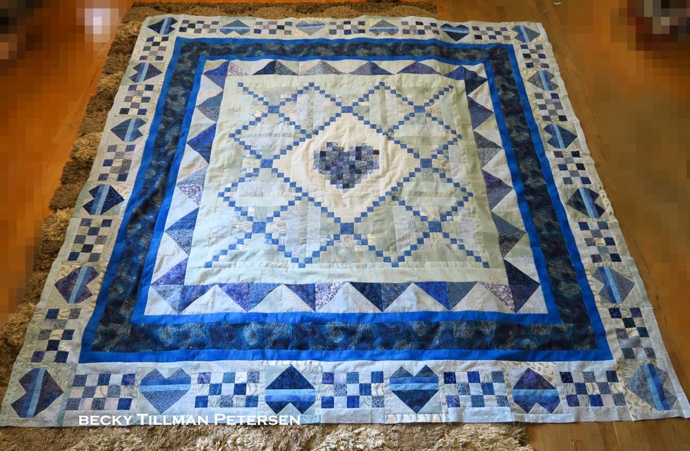 """This is where the quilt was when my husband made the comment that he thought it was finished. I told him, """"No, it's not quite big enough yet!"""" But i adjusted the inner border planned at 2.5"""" to only 1/2"""". I needed to have at least a little border to make the final one work right."""