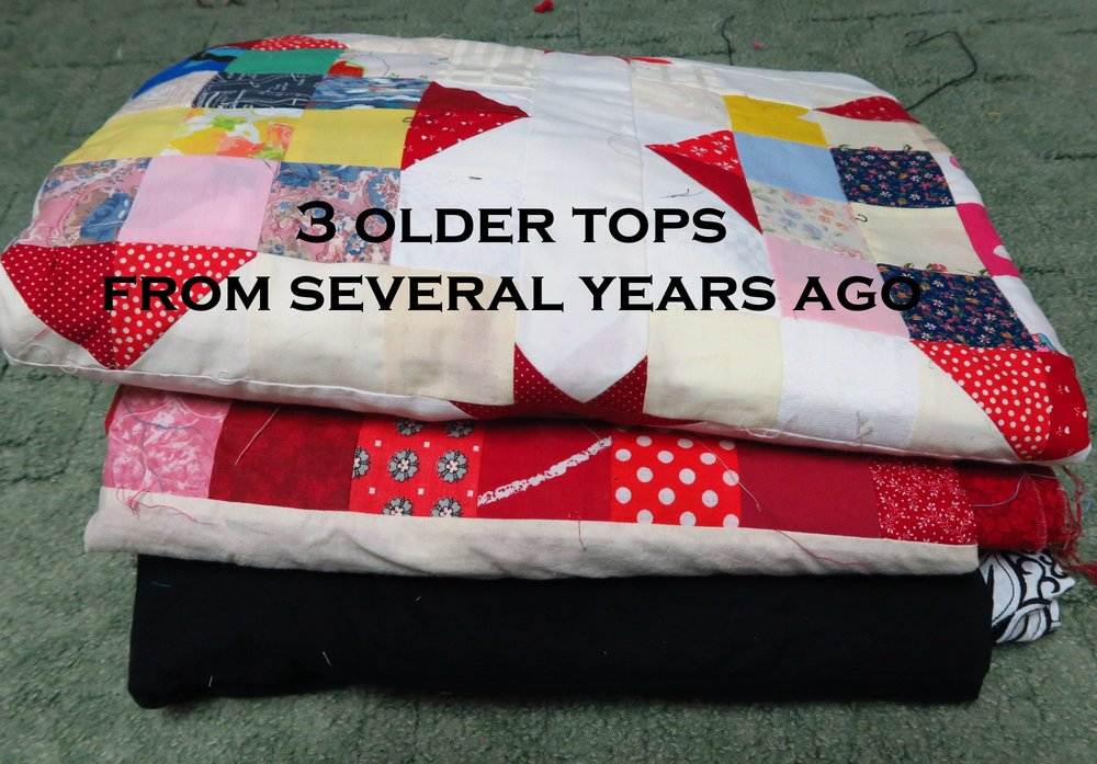 The top is an early scrappy I made. The middle one is a heart top that I really like, but didn't know how to quilt it (I think I could handle it now) and the bottom is an embroidered top - still no inspiration for quilting that one). 3 tops.