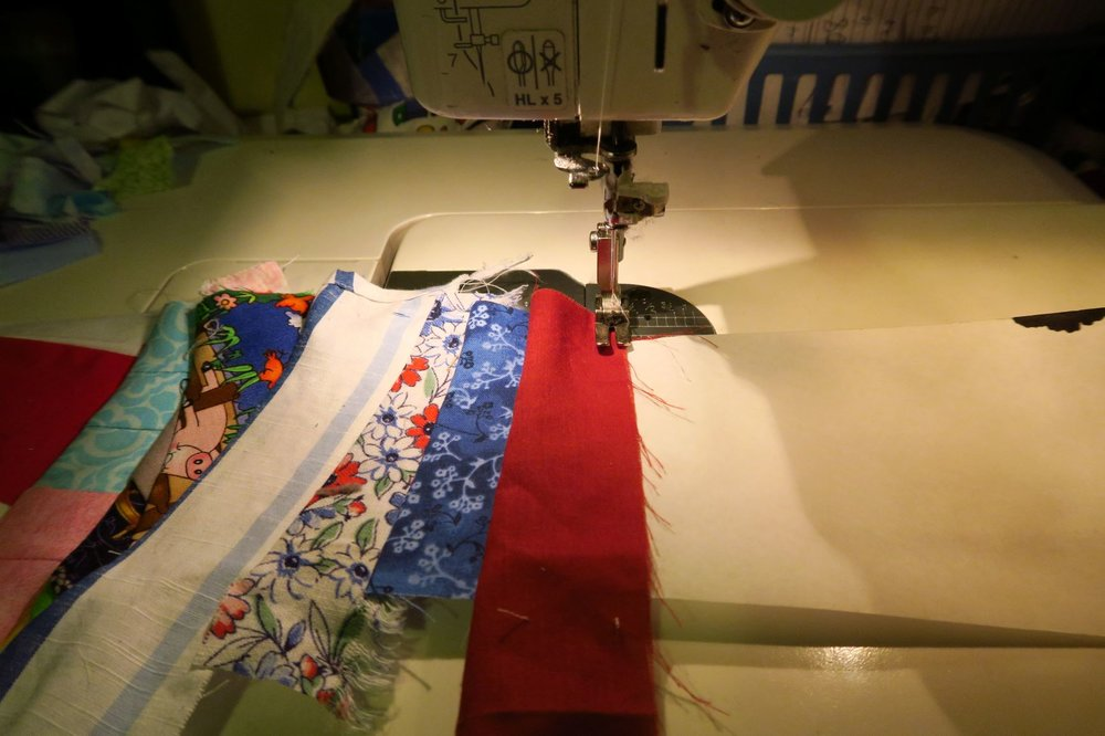 Start sewing your pieces on the paper. Use the same method as for making string blocks.