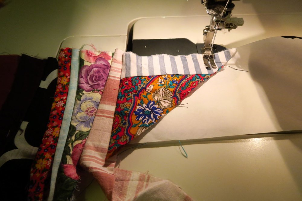 I opened out the piece that isn't a simple strip.  Because of where it is, I will sew it down to the paper without sewing a strip on it just to hold it in place.