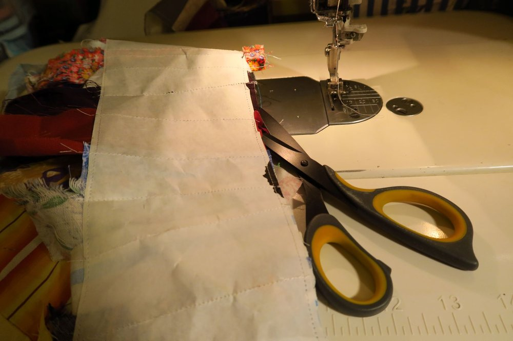 Trim (I use scissors) next to the paper. If you want and think it is easier, you can use your rotary cutter.