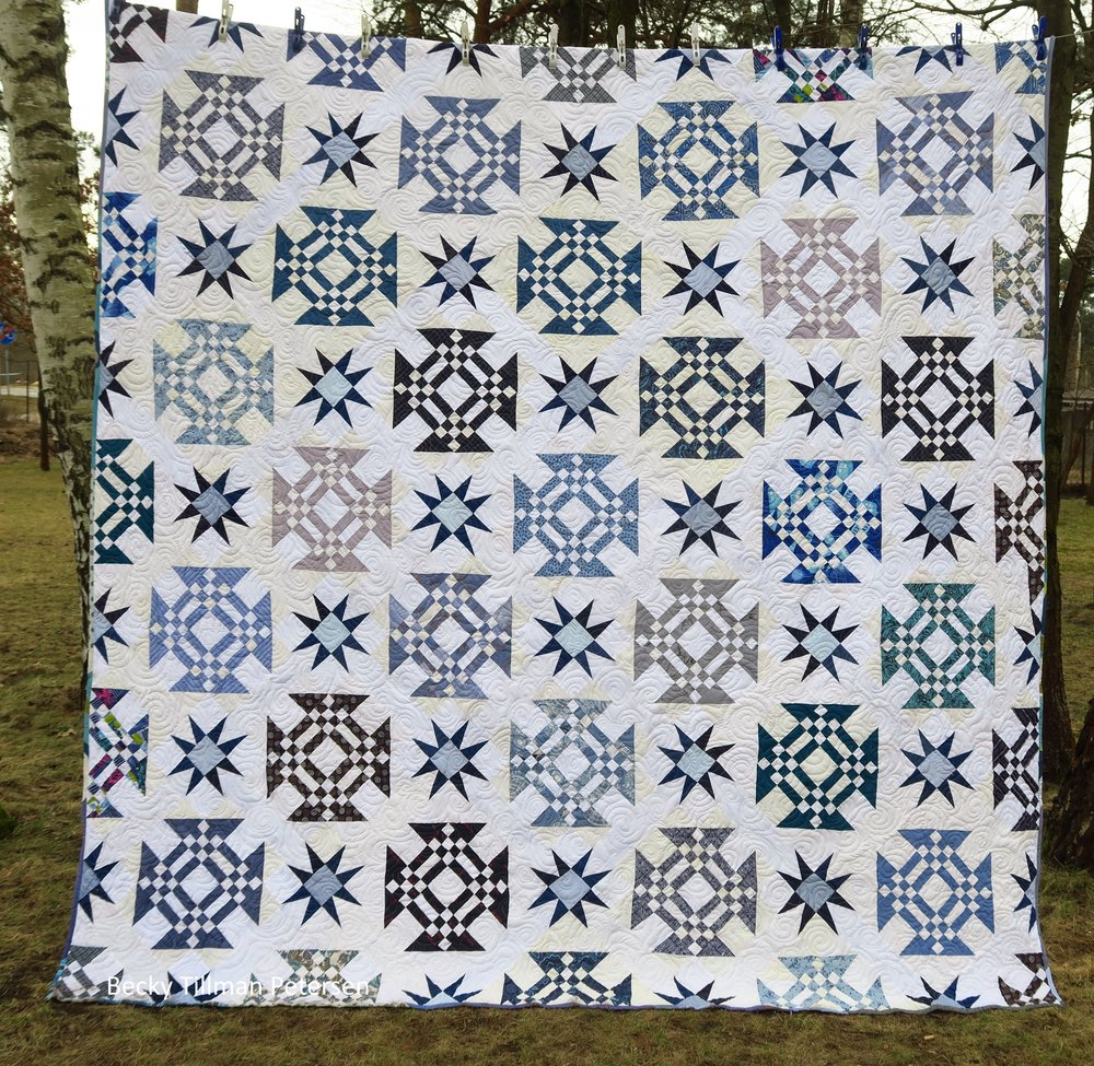 Design - a classic block put on point with a star sashing in the middle  Inspired by - a block called Goose in the Barn Door (if I remember right - it's 9 patches and rail fence blocks) - combined with my desire to try a blue/white quilt  Regrets - none, but I didn't realize that the whites were so different til I took it outside to get a picture after it was all finished. My lighting inside my house does not show up these differences like this. This was the first in my upcycled blues series - all fabrics are second hand - shirts, blouses, bedding, etc.