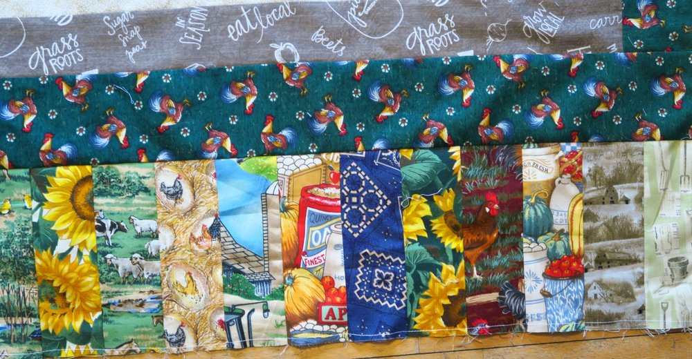 My sis said chickens are very popular fabrics for quilters. Who would have known? I surely didn't have any idea! I added some fabrics from my stash to help round out the fabrics needed for the piano key border. I had a couple of tiny John Deere pieces leftover from when I made my dad a John Deere quilt years ago, plus I threw in some sunflowers and bandanna.