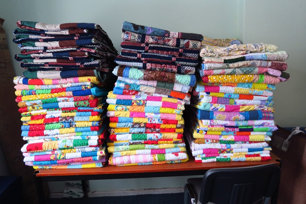 The last almost 70 quilts I still have! All but 18 are children's quilts.