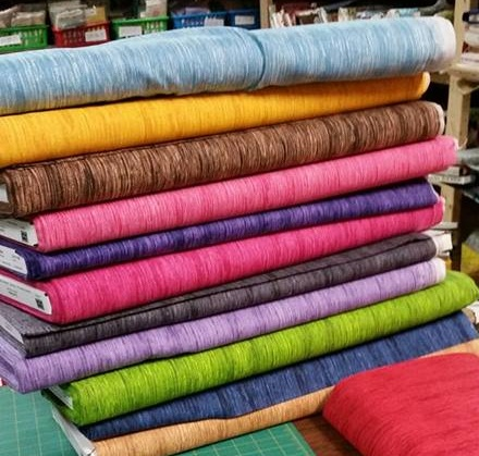 Some of the woven fabrics that the Quilted Twins carries!